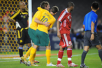 MELBOURNE, AUSTRALIA - OCTOBER 14: Harry Kewell from Australia helps his team mate Joshua Kennedy in a AFC Asian Cup 2011 match between Australia and Oman at Etihad Stadium on October 14, 2009 in Melbourne, Australia. Photo Sydney Low www.syd-low.com