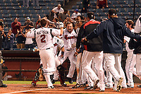 Nashville Sounds outfielder Kevin Mattison (2) is greeted at home by teammates including Sean Halton (44- center) after hitting a walk off home run during a game against the Omaha Storm Chasers on May 19, 2014 at Herschel Greer Stadium in Nashville, Tennessee.  Nashville defeated Omaha 5-4.  (Mike Janes/Four Seam Images)