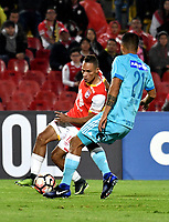 BOGOTA - COLOMBIA – 16 – 03 - 2017: Anderson Plata (Izq.) jugador de Independiente Santa Fe, disputa el balon con Josepmir Ballon (Der.) jugador de Sporting Cristal, durante partido entre Independiente Santa Fe de Colombia y Sporting Cristal de Peru, de la fase de grupos, grupo 2, fecha 2 por la Copa Conmebol Libertadores Bridgestone 2017, en el estadio Nemesio Camacho El Campin, de la ciudad de Bogota. / Anderson Plata (L) player of Independiente Santa Fe, fights for the ball with Renzo Revoredo (R) player of Sporting Cristal, during a match between Independiente Santa Fe of Colombia and Sporting Cristal of Peru, of the group stage, group 2 of the date 2, for the Conmebol Copa Libertadores Bridgestone 2017 at the Nemesio Camacho El Campin in Bogota city. VizzorImage / Luis Ramirez / Staff.