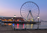 Seattle, Washington<br /> Seattle Great Wheel, a Ferris wheel on the Elliott Bay waterfront at dawn