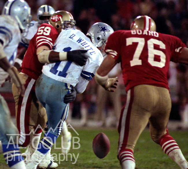 San Francisco 49ers vs. Dallas Cowboys at Candlestick Park Monday, December 19, 1983..49ers beat the Cowboys  42-17.San Francisco 49ers Linebacker Willie Harper (59) Sacks Dallas Quarterback Danny White. (11)...
