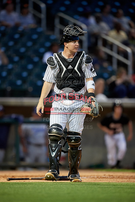 Birmingham Barons catcher Zack Collins (24) during a game against the Pensacola Blue Wahoos on May 8, 2018 at Regions FIeld in Birmingham, Alabama.  Birmingham defeated Pensacola 5-2.  (Mike Janes/Four Seam Images)
