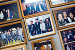 "Photos of clients, including celebrities and politicians, line the walls of the Yasuda family's ""Yakata-bune"" pleasure boat business in Tokyo, Japan on 30 August  2010. .Photographer: Robert Gilhooly"