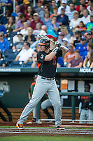 Zack Collins (0) of the Miami Hurricanes bats during a game between the Miami Hurricanes and Florida Gators at TD Ameritrade Park on June 13, 2015 in Omaha, Nebraska. (Brace Hemmelgarn/Four Seam Images)