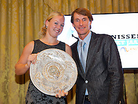 December 08, 2014, Amsterdam, Amstel Hotel, Tennis player off the Year Awards, Kiki Bertens receives the Betty Stove plate from Fedcup captain Paul Haarhuis<br /> Photo: Henk Koster