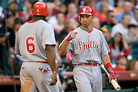 Philadelphia Phillies OF Raul Ibanez greets Ryan Howard (6) against the Houston Astros on Turn Back the Clock Nite. Game played on Saturday April 10th, 2010 at Minute Maid Park in Houston, Texas.  (Photo by Andrew Woolley / Four Seam Images)
