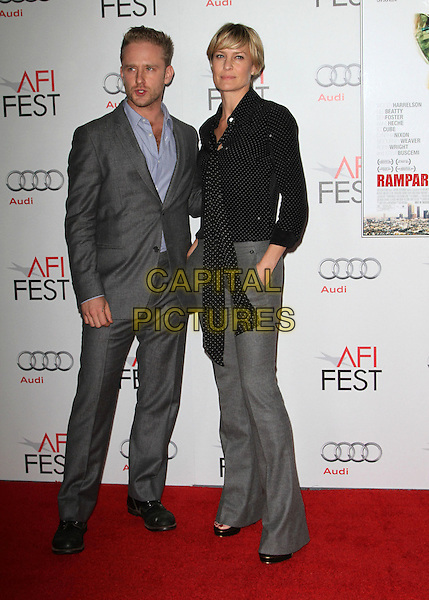 "Ben Foster & Robin Wright.AFI Fest 2011  Premiere Of ""Rampart"" Held At Grauman's Chinese Theatre, Hollywood, California, USA..November 5th, 2011.full length suit trousers black jacket scarf blue grey gray stubble facial hair polka dot.CAP/ADM/KB.©Kevan Brooks/AdMedia/Capital Pictures."