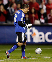 Real Salt Lake goalkeeper Nick Rimando (18) is pumped after stopping a penalty kick by Chicago Fire midfielder Logan Pause.  Real Salt Lake defeated the Chicago Fire in a penalty kick shootout 0-0 (5-4 PK) in the Eastern Conference Final at Toyota Park in Bridgeview, IL on November 14, 2009.