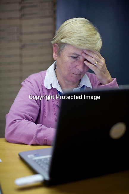 JOHANNESBURG, SOUTH AFRICA - APRIL 13: Majorie Jobson, a commissioner, works on her computer in the Khulumani offices on April 13, 2010, in central Johannesburg, South Africa. She is involved in the Daimler complaint brought forward by victims of Apartheid. The plaintiffs argue that Daimler sold vehicles to the old South African government. (Photo by Per-Anders Pettersson/Agentur Focus For Spiegel Magazine)