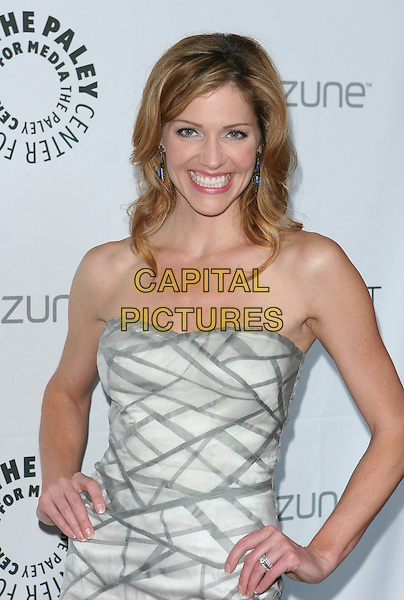 "TRICIA HELFER .The 26th Annual William S. Paley Television Festival presents ""Battlestar Galactica / Caprica"" held at Arclight Cinemas, Hollywood, CA, USA, .April 20th 2009..half length strapless white grey gray print dress hands on hips.CAP/ADM/TC.©T. Conrad/Admedia/Capital Pictures"