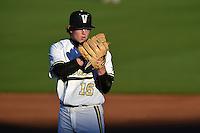 Vanderbilt Commodores starting pitcher Carson Fulmer (15) looks in for the sign during a game against the Indiana State Sycamores on February 20, 2015 at Charlotte Sports Park in Port Charlotte, Florida.  Vanderbilt defeated Indiana State 3-2.  (Mike Janes/Four Seam Images)