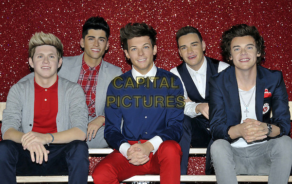 Waxworks of One Direction  - Niall Horan, Zayn Malik, Louis Tomlinson, Liam Payne & Harry Styles .are unveiled at at Madame Tussauds on April 18th 2013 in London, England, UK, April 18th 2013..half length waxwork wax work figure hair blue navy jacket white cross necklace 1D 1Direction boy band group red shirt cardigan jeans .CAP/DS.©Dudley Smith/Capital Pictures