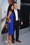 WESTWOOD, CA- AUGUST 07: Actor Matt Damon (R) and wife Luciana Barroso arrive at the Los Angeles premiere of 'Elysium' at Regency Village Theatre on August 7, 2013 in Westwood, California.