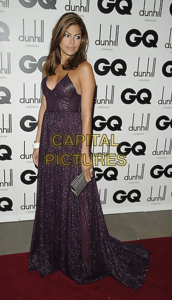 EVA MENDES.The GQ Men Of The Year Awards 2009 held at the Royal Opera House, Covent Garden, London, England. .8th September 2009 .full length purple aubergine mendes long maxi dress silver grey gray clutch bag white bracelet looking over shoulder .CAP/CAN.©Can Nguyen/Capital Pictures.