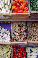 Colorful fresh produce & mushrooms on display in the golden-stone village of GORDES  - PROVENCE, FRANCE