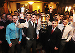Michael Moloney and Liam O' Donovan celebrate with their team-mates during Éire Óg GAA's medal presentation night at the Auburn Lodge Hotel in Ennis. Photograph by Declan Monaghan