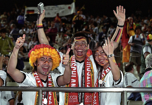 5 June 2002: Happy German fans wave before the match against Ireland, 2002 FIFA World Cup, Ibaraki, Japan. Photo: Neil Tingle/actionplus...020605 football soccer crowd crowds supporter fan painted face japanese