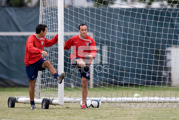 USMNT captain Landon Donovan stretches out on a goal with defender Jonathan Bornstein during practice at the auxiliary pitch next to RFK Stadium, in Washington, DC.