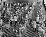 medical school training, circa 1959, dentists at dental stations with chairs and dummy patient