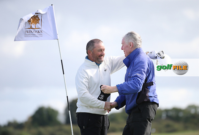 Damien McGrane (IRL) celebrates winning the final round of  The 106th Irish PGA Championship with caddie Keiran Walsh (Headfort GC President), at the Moy Valley Hotel & Golf Resort, Kildare, Ireland.  25/09/2016. Picture: David Lloyd | Golffile.