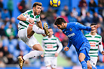Sergi Enrich Ametller of SD Eibar (L) trips up with Markel Bergara of Getafe CF (R) during the La Liga 2017-18 match between Getafe CF and SD Eibar at Coliseum Alfonso Perez Stadium on 09 December 2017 in Getafe, Spain. Photo by Diego Souto / Power Sport Images