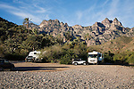 """RVs owned by americans and canadians at """"free beach"""" in Juncalito, Baja Sur, Mexico near Loretto.  Sierra giganta in background.  February.."""