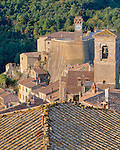 Tuscany, Italy<br /> Bell towers above the terraced buildings and tiled roofs of Sorano, a hill town in southern Tuscany