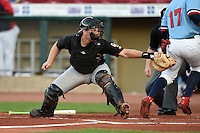 Quad Cities River Bandits catcher Brett Booth (9) attempts to swipe tag J.D. Williams (17) scoring a run during a game against the Cedar Rapids Kernels on August 19, 2014 at Perfect Game Field at Veterans Memorial Stadium in Cedar Rapids, Iowa.  Cedar Rapids defeated Quad Cities 5-3.  (Mike Janes/Four Seam Images)