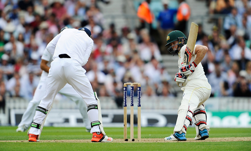 Australia's Chris Rogers watching on carefully as England's Jos Buttler takes the ball cleanly<br /> <br /> Photographer Ashley Western/CameraSport<br /> <br /> International Cricket - Investec Ashes Test Series 2015 - Fifth Test - England v Australia - Day 1 - Thursday 20th August 2015 - Kennington Oval - London<br /> <br /> &copy; CameraSport - 43 Linden Ave. Countesthorpe. Leicester. England. LE8 5PG - Tel: +44 (0) 116 277 4147 - admin@camerasport.com - www.camerasport.com