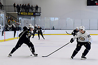 June 29, 2018: Boston Bruins forward Pavel Shen (51) passes the puck to himself between his skates during a scrimmage at the Boston Bruins development camp held at Warrior Ice Arena in Brighton Mass. Eric Canha/CSM