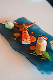 PORTUGAL, Lisbon, a blue plate with Algarve Shrimp in Feitoria restaurant and Wine Bar