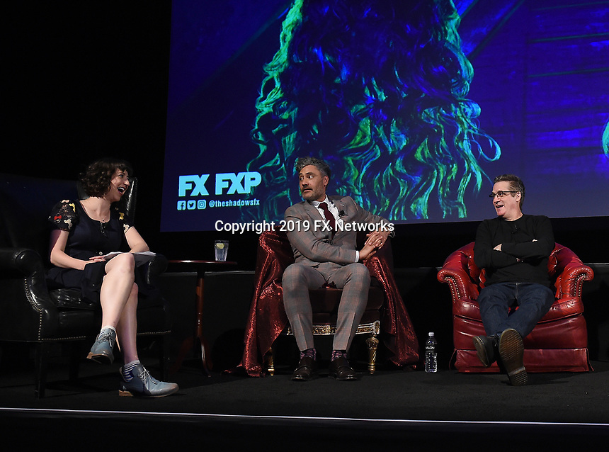 """HOLLYWOOD - MAY 22: (L-R) Moderator Kristen Schaal, Executive Producer/Director Taika Waititi, and Executive Producer/Writer Paul Simms attend FX's """"What We Do in the Shadows"""" FYC event at Avalon Hollywood on May 22, 2019 in Hollywood, California. (Photo by Frank Micelotta/FX/PictureGroup)"""