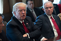 US President Donald J. Trump (L), with Attorney General Jeff Sessions (R), delivers remarks during an opioid and drug abuse listening session in the Roosevelt Room of the White House in Washington, DC, USA, 29 March 2017. Photo Credit: Shawn Thew/CNP/AdMedia