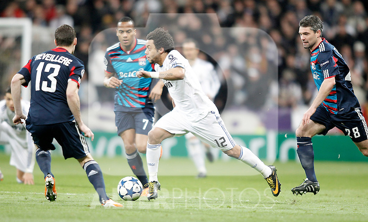 Real Madrid's Marcelo against Olympique de Lyon's Anthony Revelliere and Jeremy Toulalan during Champions League match. March 16, 2011. (ALTERPHOTOS/Alvaro Hernandez)