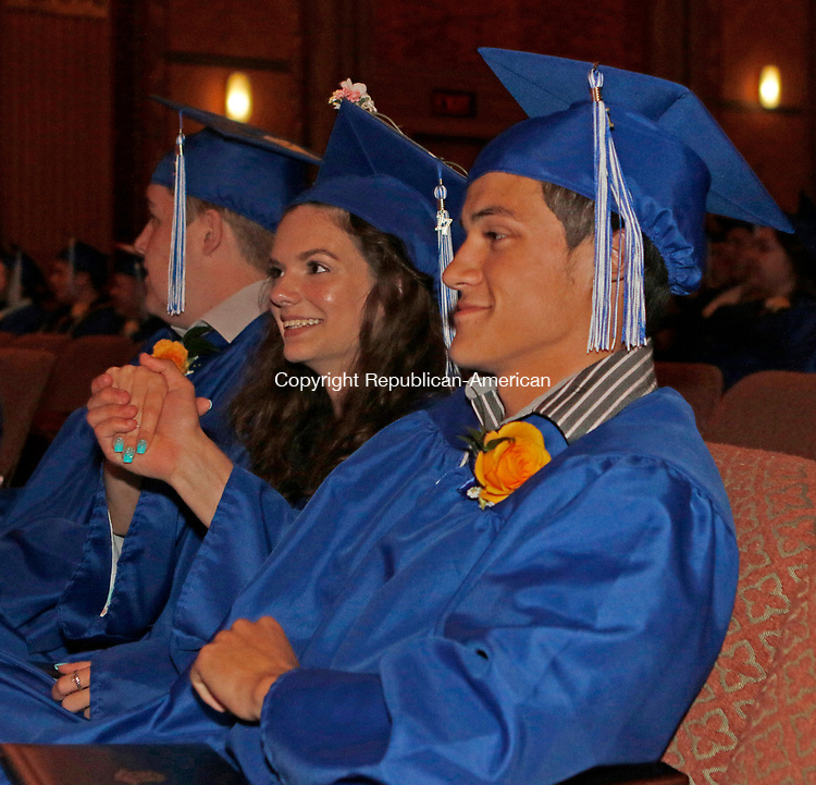 Torrington, CT 061617MK05 Sarah Klotzman and Brandon Lagasse shake hands after receiving their diplomas during the Oliver Wolcott Technical High School graduation exercises at the Warner Theatre in Torrington on Friday night. Michael Kabelka / Republican-American