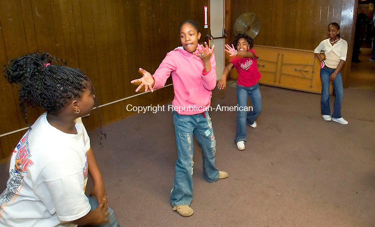 WATERBURY, CT--08 APRIL 2007--040807JS01-Talent show participants, from left, Ariel Fulton, Stevanni Lynch and Sydney Craig practice their dance moves as Chantel Smith, right, looks on prior to the Goodwill Lodge #1325 and Clock City Temple #895's Beauty and Talent Department Annual Easter Fashion and Talent Show Sunday at the Goodwill Lodge in Waterbury.<br /> Jim Shannon / Republican-American