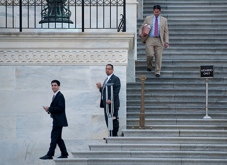 UNITED STATES - AUGUST 1: Rep. Keith Ellison, D-Minn., hobbles down the House steps at the Capitol following the vote on the debt ceiling bill in the House of Representatives on Monday, Aug. 1, 2011. (Photo By Bill Clark/Roll Call)