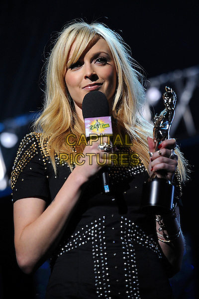 FEARNE COTTON.On stage at the Brit Awards 2009 Nominations Launch Party at the Roundhouse, London, England. .January 20th, 2009 .brits half length black silver gold studs studded dress microphone award trophy .CAP/LEO.© LEO/Capital Pictures.