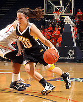 Dec. 18, 2010; Charlottesville, VA, USA; UMBC Retrievers guard Michelle Kurowski (20) drives past Virginia Cavaliers guard Paulisha Kellum (3) during the game at the John Paul Jones Arena.  Mandatory Credit: Andrew Shurtleff-