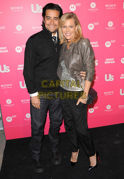 RICH OROSCO & JULIE BENZ.The Annual US Weekly Hot Hollywood Style Party at Drai's in Hollywood, California, USA..April 22nd, 2010                                                                    .full length jacket silver grey gray leather sequins sequined black stubble facial hair trousers jeans denim .CAP/RKE/DVS.©DVS/RockinExposures/Capital Pictures.