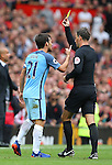 David Silva of Manchester City receives a yellow card during the Premier League match at Old Trafford Stadium, Manchester. Picture date: September 10th, 2016. Pic Simon Bellis/Sportimage