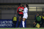 DURHAM, NC - NOVEMBER 11: Duke's Kayla McCoy (12) collides with UNCG goalkeeper Aiyana Tyler-Cooper (left). The Duke University Blue Devils hosted the UNCG Spartans on November 11, 2017 at Koskinen Stadium in Durham, NC in an NCAA Division I Women's Soccer Tournament First Round game. Duke won the game 1-0.