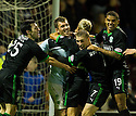 HIBS PLAYERS RUSH TO CONGRATULATE KEEPER  MARK BROWN AFTER HE SAVED NICKY LAW'S PENALTY TO PUT HIBS THROUGH