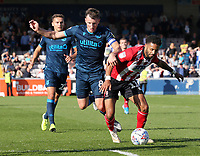 Lincoln City's Bruno Andrade goes down under the challenge from Bristol Rovers' Ollie Clarke<br /> <br /> Photographer Rich Linley/CameraSport<br /> <br /> The EFL Sky Bet League One - Lincoln City v Bristol Rovers - Saturday September 14th 2019 - Sincil Bank - Lincoln<br /> <br /> World Copyright © 2019 CameraSport. All rights reserved. 43 Linden Ave. Countesthorpe. Leicester. England. LE8 5PG - Tel: +44 (0) 116 277 4147 - admin@camerasport.com - www.camerasport.com