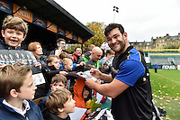 Nathan Catt of Bath Rugby mingles and signs autographs with supporters at the end of the session. Bath Rugby Captain's Run on October 30, 2015 at the Recreation Ground in Bath, England. Photo by: Patrick Khachfe / Onside Images