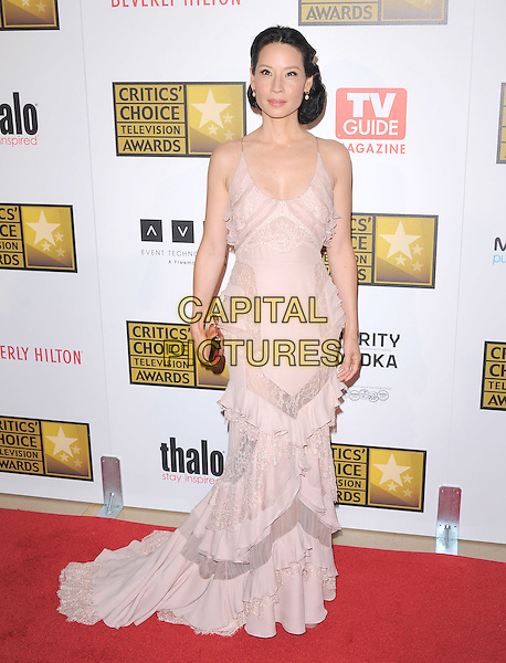 Lucy Liu.The 2nd Annual Critics' Choice Television Awards  held at The Beverly Hilton in Beverly Hills, California, USA..June 18th, 2012.full length dress ruffle pink beige clutch bag train.CAP/RKE/DVS.©DVS/RockinExposures/Capital Pictures.