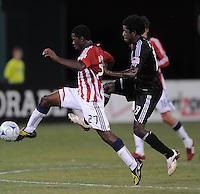 Chivas USA midfielder Michael Lahoud (27) controls the ball against DC United midfielder Clyde Simms (19).  Chivas USA defeated DC United 2-0  at RFK Stadium, Saturday October 3, 2009.