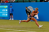 June 12th 2017,  Nottingham, England; WTA Aegon Nottingham Open Tennis Tournament day 3; Qualifier Jana Fett of Croatia stretches to hit a forehand back to 7th seed Mona Barthel of Germany; Fett who she beat  6-3 5-7 7-5 Fett saved 3 match points before winning