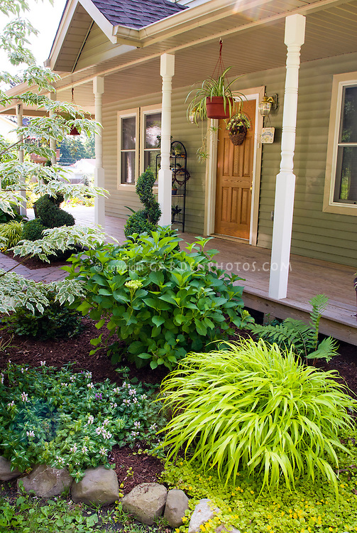 Front garden entry landscaping plant flower stock for Curb appeal garden designs