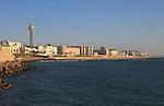 Coastal view east of rock armour coastal defences near city centre, Cadiz, Spain